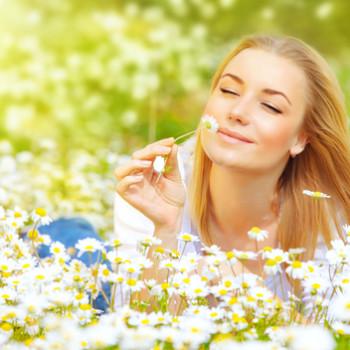 Woman in chamomile field